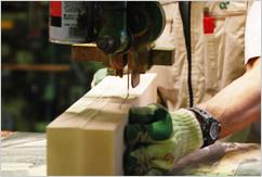 Craftman cutting wood